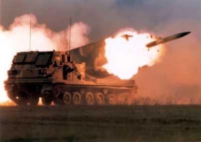 MLRS launcher firing